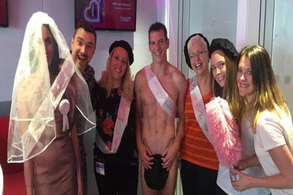 Naked male stripper and customers from hen party at life drawing class in Ireland