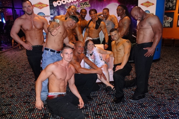 Many topless male strippers and a customer posing at birthday party in Ireland and Northern Ireland