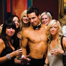 Hot topless butler posing with clients in Waterford, Ireland