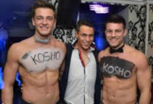 Topless butlers having fun with a client in Cork, Ireland